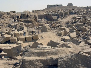 Modern quarrying in the ancient granite quarries at Aswan. Note ancient object in the foreground