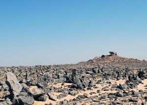 Field of upright stones with the sanctuary at Gebel Tingar in the background