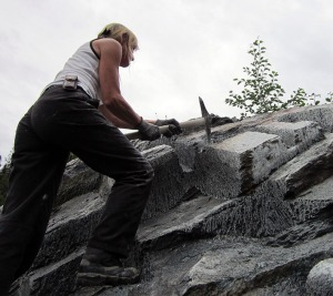 Eva Stavsøien extracting soapstone the traditional way with a pick axe