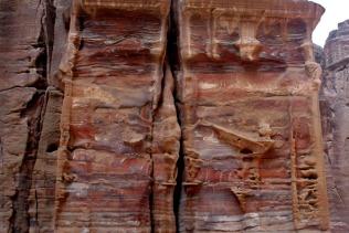 Jordan (Petra): weathering red sandstone temple facade