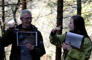 Torbjørn Løland and his pupil explaining us a quarry for early stone crosses - and millstone