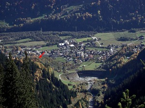 Looking down the Punteglias valley towards Trun in Vorderrheintal. Note the large basin, built to protect the village from avalanches and the like. The red arrow points towards the Cartatscha medieval castle ruin.