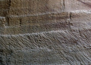 The difference between cutting trenches with chisel and mallets (straight lines), and pickaxe (curved marks). Small Graeco-Roman quarry at Elkab, Upper Egypt