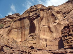 Tall sandstone quarry at vertical cliff in Petra (Jordan)