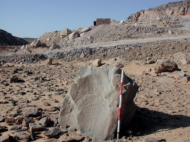 Subeira: A lonely stone with Predynastic rock art and a modern clay mine in the background. Photo: Adel Kelany