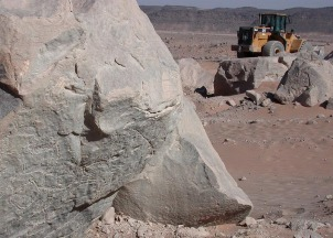 Heavy machinery is never far away from rock art in Subeira. Here a location of Predynastic petroglyphs. Photo: Adel Kelany
