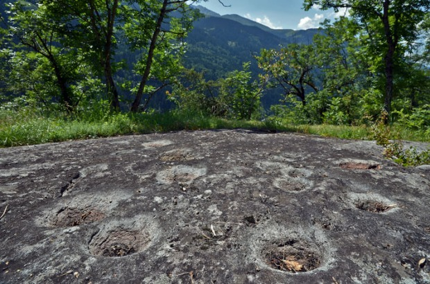 Apart from famous Carschenna there are few real rock art sites in Grisons. But there is a wealth of prehistoric sites with cup marks (German: Schalensteine), such as this site called Grep Patnasa by Dardin near Brigels in Surselva. More info at Wikipedia and steinkreis.ch. Photo: Per Storemyr