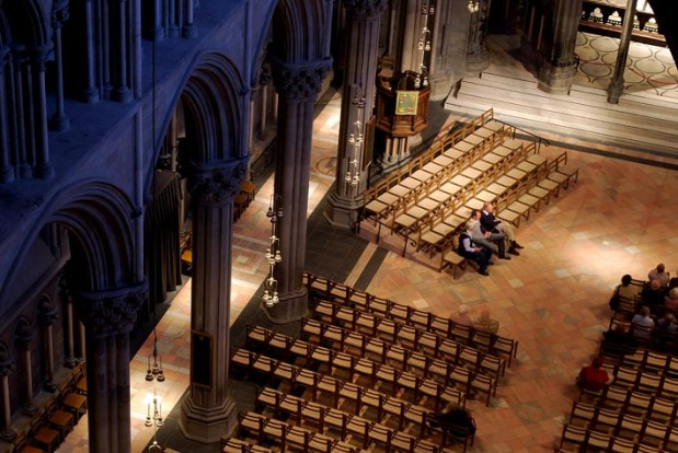 "Restored floor of the choir at Nidaros Cathedral. The black slate between the pillars was provided from ""Sorte Skifer"" in the late 19th century, whereas the reddish stone is the famous marble from the Fauske quarries in Northern Norway. Photo: Per Storemyr"