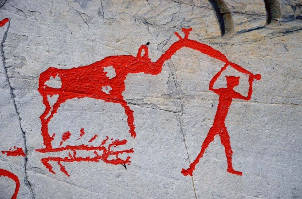 "Elk and human connected with a so-called ""elk-headed pole"" in the Alta rock art. It is not known what the pole may represent. And what about the structure below the elk? Is it a pit so commonly used in elk hunting almost up till today? Photo: Per Storemyr"