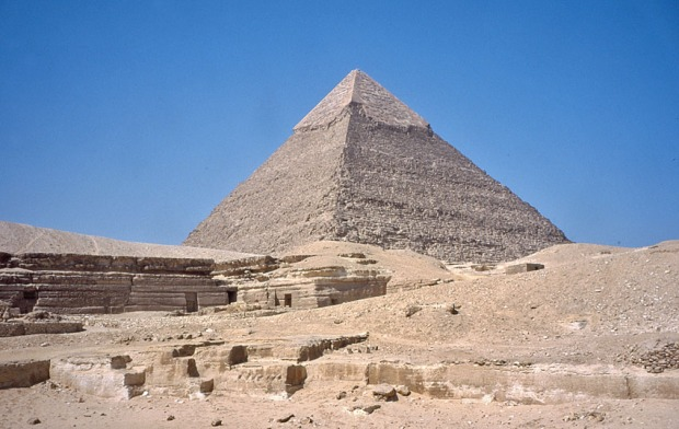 Pharaoh Chephren's pyramid at Giza, with remaining casing stones from the quarries at Tura at the top. In the foreground part of the local quarries that were used to for providing backing stones for the pyramids. Photo: Per Storemyr