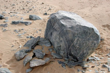 Shattered stone surfaces at Chephren's quarry, Old Kingdom. Firesetting used to peel the block making it suitable for further work with hammerstones to create a sculpture. Photo: Per Storemyr