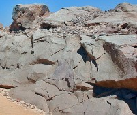 Fire shattered rock surfaces at the silicified sandstone quarries by Gharb Aswan (West Aswan). Most likely a sign of an important stone extraction method in the New Kingdom. Photo: Per Storemyr