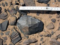 A biface (hand axe) in the Wadi Beiza Palaeolithic quarries. Photo: Per Storemyr