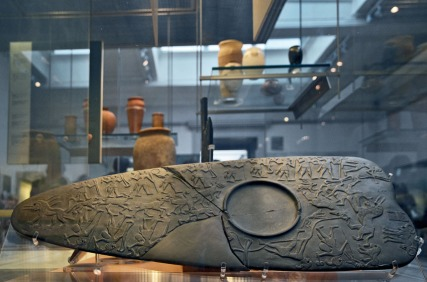 """Egypt, or rather the British Museum. The famous """"Hunters' Palette"""" from the Late Predynastic period, late fourth millennium BC. It is made from the schist/greywacke quarries in Wadi Hammamat, a place that I tend to take an interest in at the moment. Photo: Per Storemyr."""