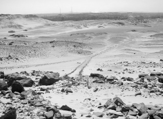Causeway descending the southern side of Gebel Gulab from a probably New Kingdom quarry location (in the front). Photo: Per Storemyr
