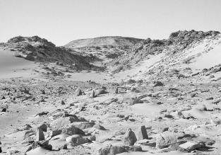 Part of a large field of upright stones in a side wadi to Wadi el-Tilal, about one km north of St. Simeon's monastery, looking north. On the hill to the right is a possible Early Christian hermitage. Photo: Per Storemyr