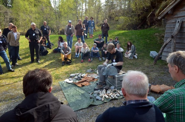The annual Hyllestad seminar draws researchers and laypersons to the centre. Here from the April 2014 seminar, with archaeologist Morten Kuchera demonstrating flint knapping. Photo by Per Storemyr