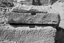 Lever sockets in the New Kingdom part of the Nag el-Hammam sandstone quarry near Gebel el-Silsila. Splitting occurred along horizontal bedding planes within the rock. Smallest scale division is 1 cm. Photo by JAMES HARRELL.