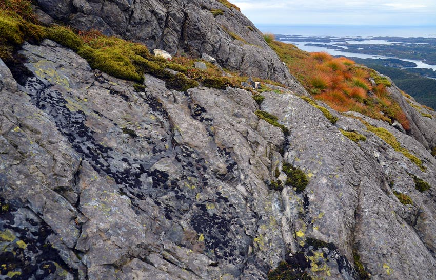 A quarry with a view to the Atlantic Ocean. Traces of firesetting at the Siggjo Neolithic rhyolite quarries. Photo by Per Storemyr