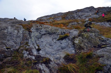 A shallow hole in the rock. Traces of firesetting at the Siggjo Neolithic rhyolite quarries. Photo by Per Storemyr