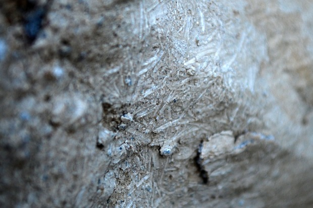 Sideway growth of micro icicles: Ice growing like needles along plaster, finding its way into weak parts and lifting small pieces. Masonry of limekiln in Hyllestad, Western Norway. Width of image c. 2 cm. Photo by Per Storemyr