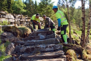 Impressed by the way Nepalese sherpa stone workers build a staircase in Hyllestad, Western Norway. Only manual work. Just looking. Photo by Per Storemyr