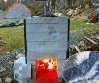 Forsiktig brenning for å drive av fukt i ovn og marmor. Legg merke til at ovnen er forsterket med vinkeljern og streng. Foto: Per Storemyr
